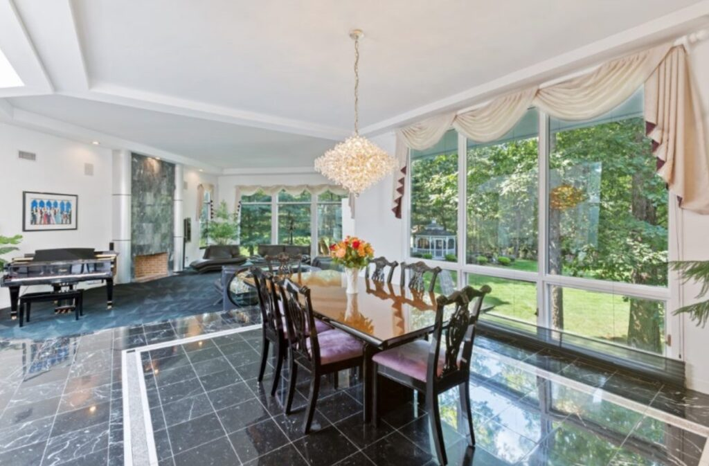 The dining room at Gloria Gaynor's home is bright and reflects the classy style of the beloved musical artist - Elliman photo